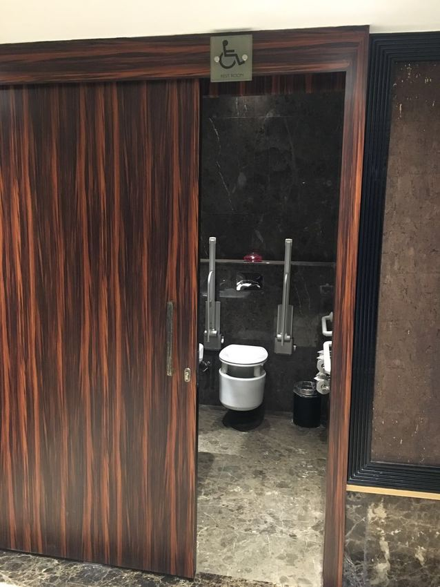 Large washroom for accessible guests  at lobby level  wtih sliding door