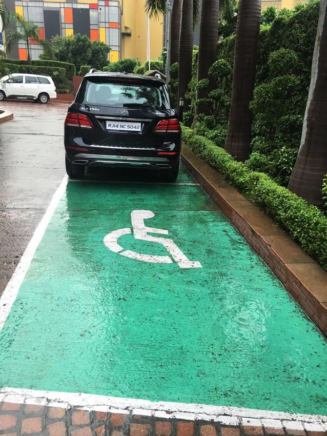 Large reserved parking for accessible guests at extended main porch